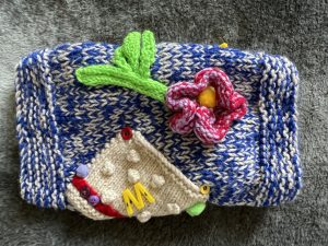 Hand knitted twiddle muff